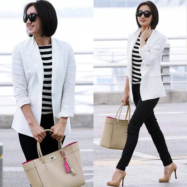 Flu Soo Ae tạo nên sự khác biệt khi mix áo thun Hàn Quốc kẻ sọc đen trắng kết hợp với áo khoác blazer, quần jean bó sát đẳng cấp, sang trọng